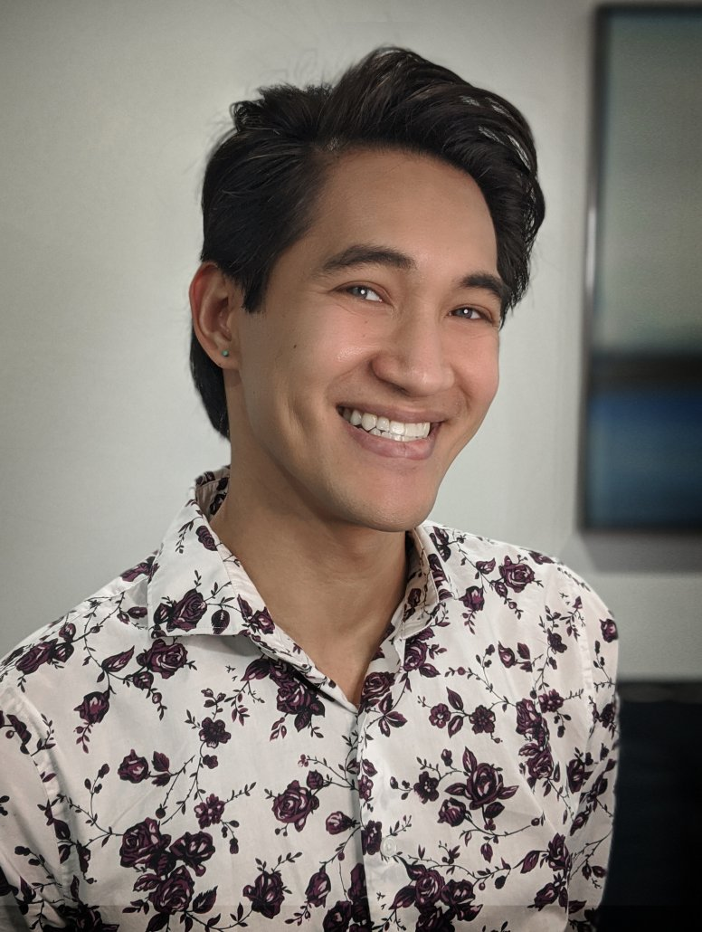 A photo of Christophe Ngo, a Licensed Marriage and Family Therapist and the owner of BeachCAT Counseling in California, is smiling and ready to help people looking for mental health therapy treatment.